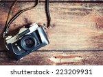 old retro camera on vintage... | Shutterstock . vector #223209931
