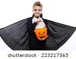 boy with pumpkin basket dressed ... | Shutterstock . vector #223217365