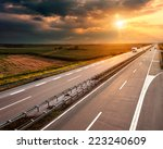 open highway at sunset  near... | Shutterstock . vector #223240609