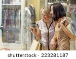 two women looking through shop... | Shutterstock . vector #223281187