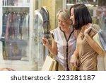 two women looking through shop...   Shutterstock . vector #223281187