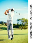 golfer playing on beautiful... | Shutterstock . vector #223328635
