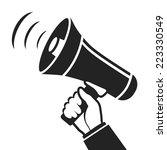 hand holding megaphone... | Shutterstock .eps vector #223330549