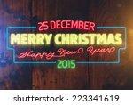 christmas neon sign. wood... | Shutterstock .eps vector #223341619