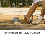Постер, плакат: Framing contractor measuring for