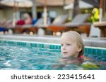 adorable girl swim at pool side ... | Shutterstock . vector #223415641