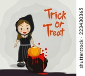 little witch with pumpkin and... | Shutterstock .eps vector #223430365