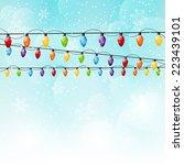 color christmas light bulbs on... | Shutterstock .eps vector #223439101