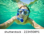 portrait of man snorkeling in... | Shutterstock . vector #223450891