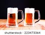 glasses of beer | Shutterstock . vector #223473364