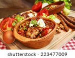 stew in pot on wooden plank.... | Shutterstock . vector #223477009