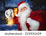 santa claus holding lantern and ... | Shutterstock . vector #223531429