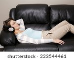 caucasian woman listening music ... | Shutterstock . vector #223544461