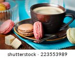 Cup Of Coffee And Macaroons On...