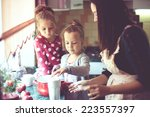 mother with her 5 years old... | Shutterstock . vector #223557397