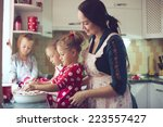 mother with three kids cooking... | Shutterstock . vector #223557427