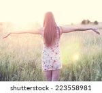 girl in a dress standing in a...   Shutterstock . vector #223558981