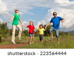 happy family walking on the... | Shutterstock . vector #223564444