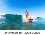 father and son surfing together.... | Shutterstock . vector #223566001