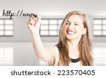 Small photo of Full website address or URL concept using woman hand writing on screen with a black marker