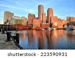Stock photo boston skyline with financial district and boston harbor at sunrise 223590931