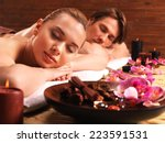 couple lying on the massage... | Shutterstock . vector #223591531