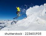 Alpine Skier Skiing Downhill ...