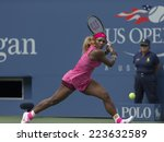 Small photo of NEW YORK, NY - SEPTEMBER 1, 2014: Serena Williams of USA returns ball during 4th round match against Kaia Kanepi of Estonia at US Open in Flushing Meadows USTA Tennis Center