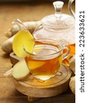 Small photo of beverage tea with ginger and fresh root on a wooden background