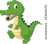 happy cartoon crocodile | Shutterstock . vector #223634191