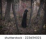 scary figure in black mantle in ... | Shutterstock . vector #223654321