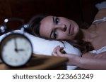 woman lying in bed suffering...   Shutterstock . vector #223663249