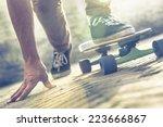 Skateboarder Riding Skateboard...