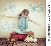 happy child pilot with vintage... | Shutterstock . vector #223712701