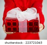 Girl Holding Christmas Gifts O...