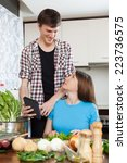 happy young couple cooking with ...   Shutterstock . vector #223736575