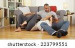 black couple sitting on floor... | Shutterstock . vector #223799551