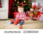 happy child on the floor under... | Shutterstock . vector #223800364