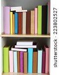books on wooden shelves close up   Shutterstock . vector #223802527