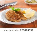 chicken or pork schnitzel with...   Shutterstock . vector #223823059