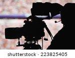 Silhoutte Of A Camera Man In A...