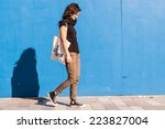 young girl dressed in casual... | Shutterstock . vector #223827004