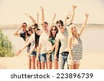 beautiful young people on beach | Shutterstock . vector #223896739