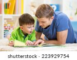 kid boy and his father read a... | Shutterstock . vector #223929754