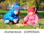 little boy and girl playing... | Shutterstock . vector #223935631
