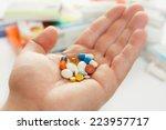 man's hand hold many medicine ... | Shutterstock . vector #223957717