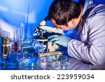 man is looking into the  glass... | Shutterstock . vector #223959034