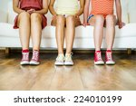 three young girls sitting on... | Shutterstock . vector #224010199