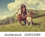 Stock photo woman with beagle on mountain hill 224015284