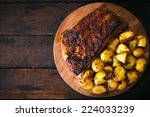 baked potatoes and beef ribs in ... | Shutterstock . vector #224033239